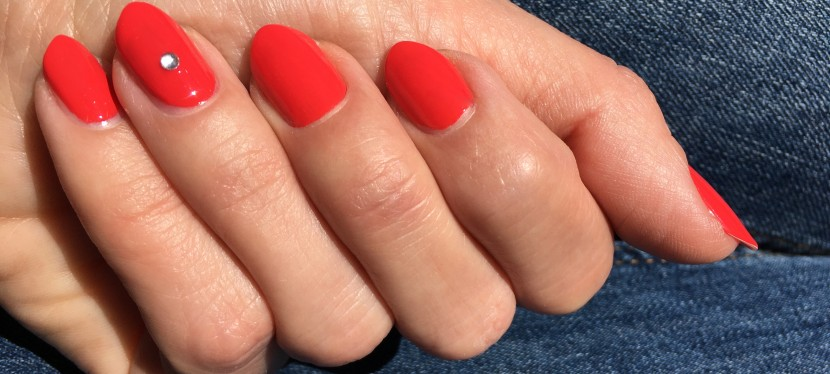 Stunning coral red nails with ESSIE Sizzling Hot
